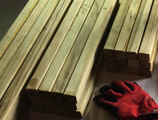 DIY lighted Christmas presents step one - cut wood into three sizes
