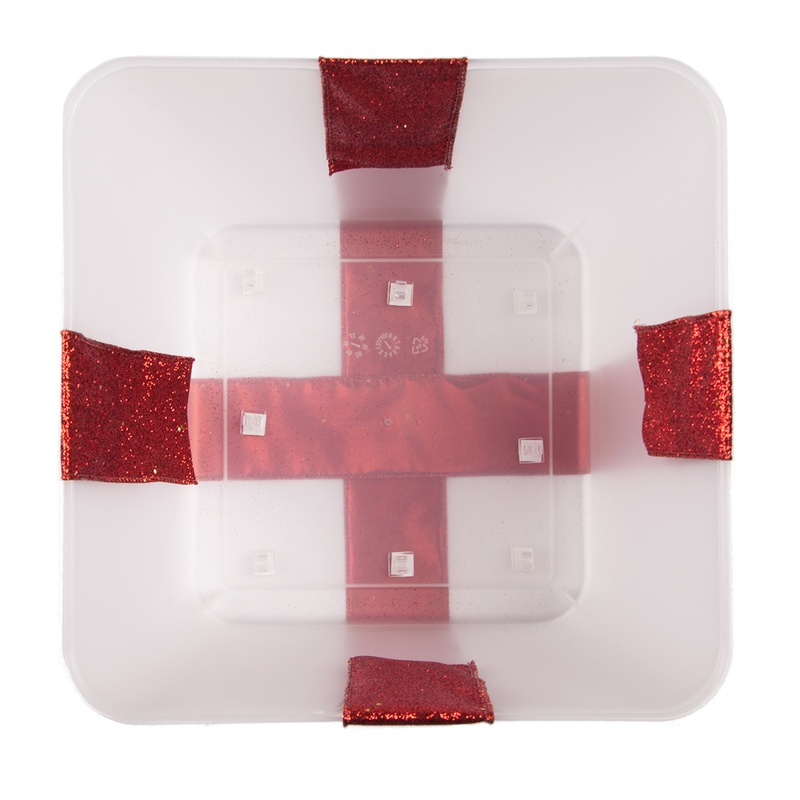 Secure your ribbon on all four sides of your lighted Christmas gift box.