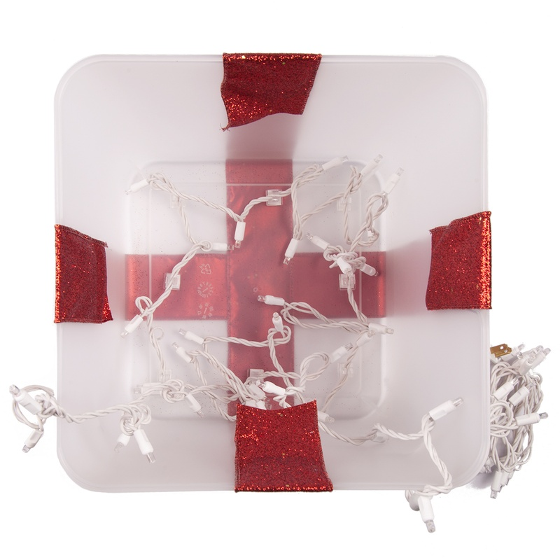 Clip your light strings into place, this will create a uniform glow inside of your lighted present.