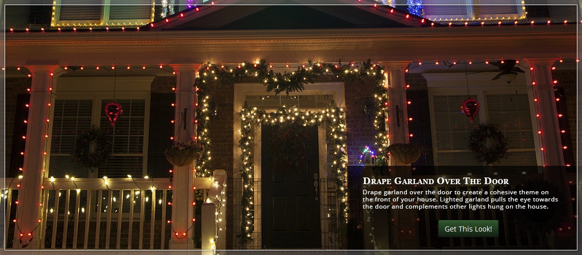 Christmas garland draped around a front door