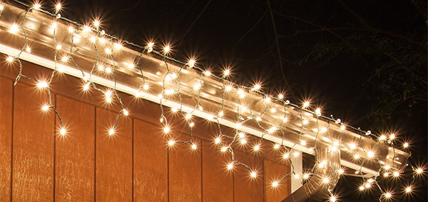 clear incandescent icicle lights along the roof
