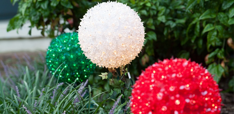 Decorate the yard with whimsical starlight stakes for Christmas.