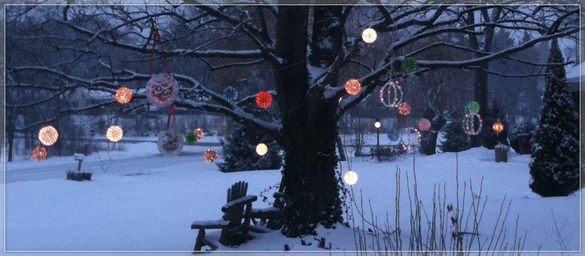 Hang starlight spheres and Christmas light balls from tree branches.