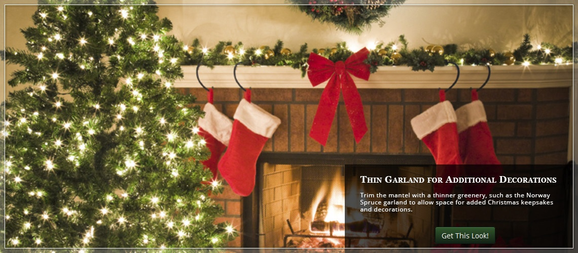 use thin garland along the mantel to make room for added Christmas decorations