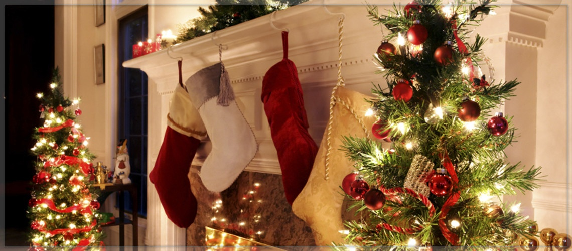 Hang Christmas stockings across the mantel