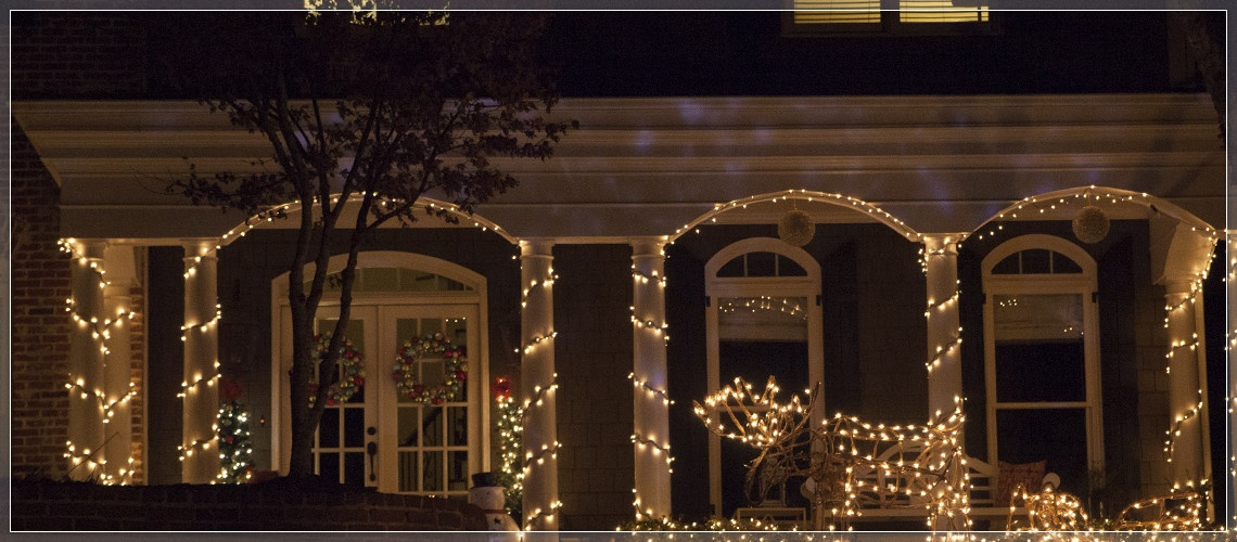 Porch columns wrapped with Christmas lights