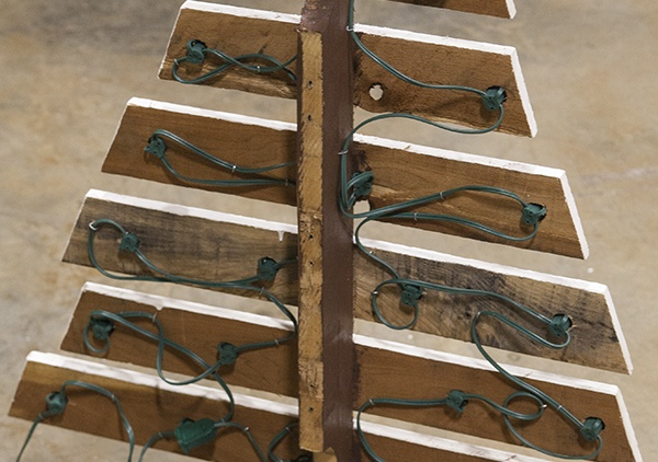 DIY Marquee Pallet Trees Step Eight - Place Light Sockets Through Drill Holes