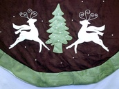 "56"" 56"" Purple and Green Suede Reindeer Tree Skirt"