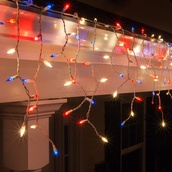 150 Red/Clear Frost/Blue Icicle Lights - White Wire