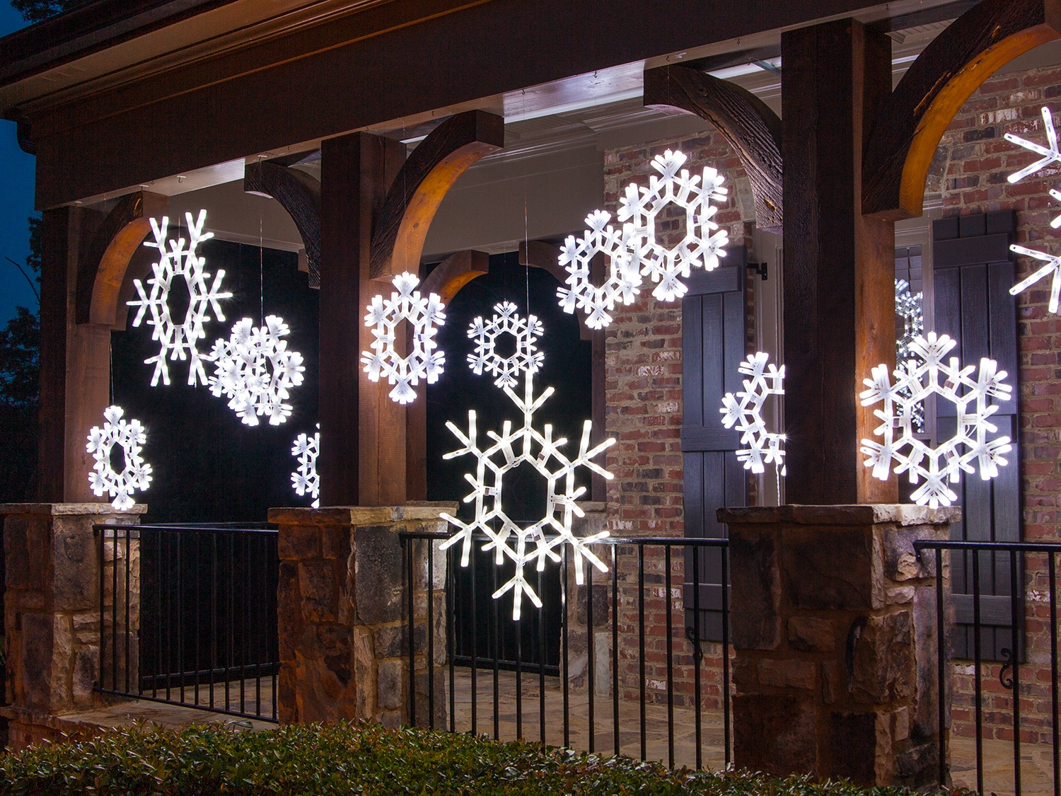Hang Christmas snowflakes across the porch.