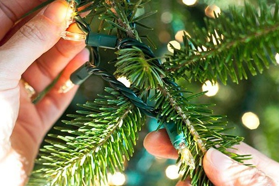 weave christmas lights in and out of branches - How To String Lights On A Christmas Tree