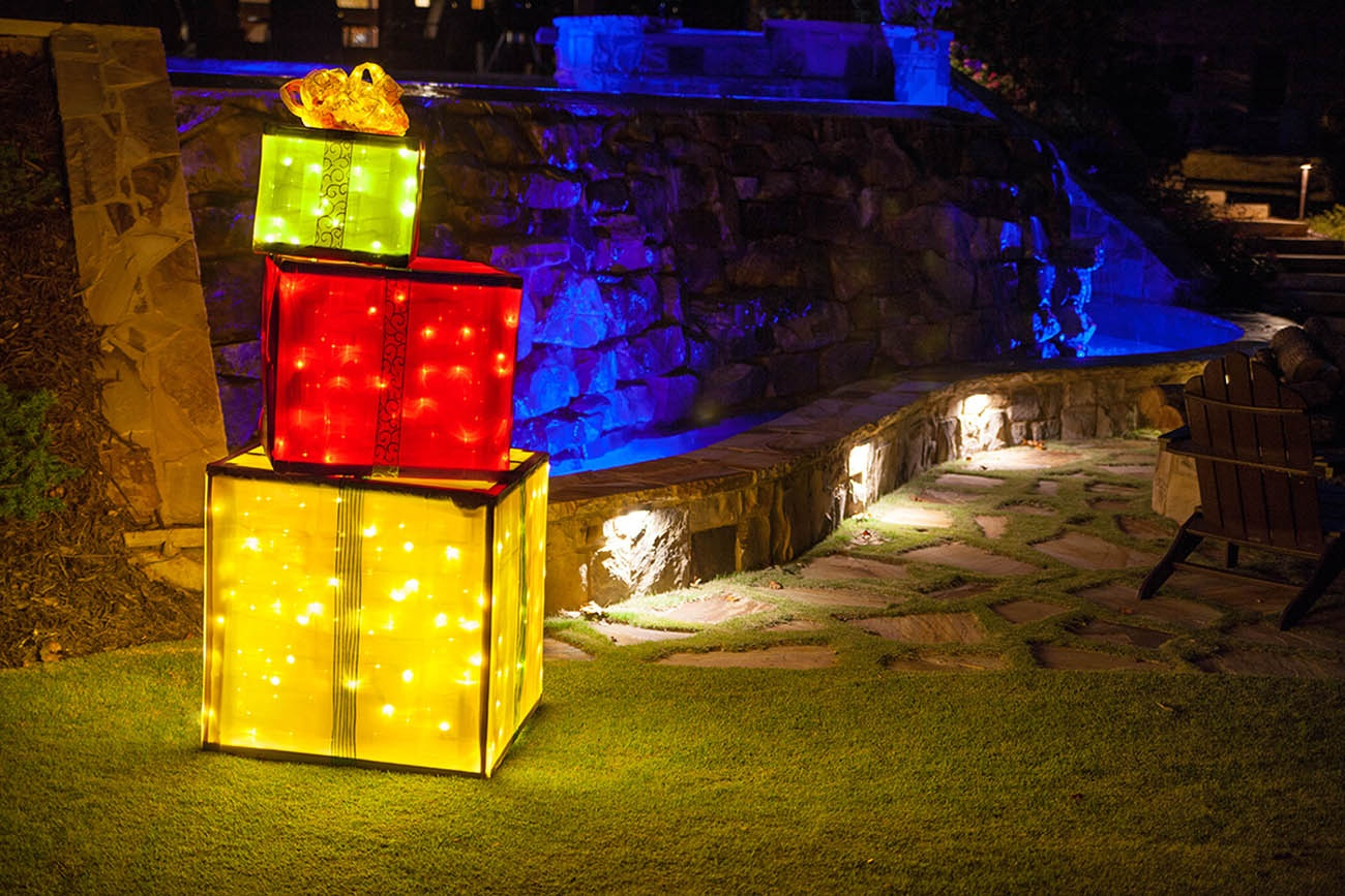 Place your DIY lighted Christmas presents in the yard for a high impact holiday light display!