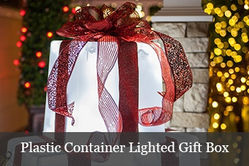 DIY lighted gift boxes using a plastic container, string lights and holiday ribbon.
