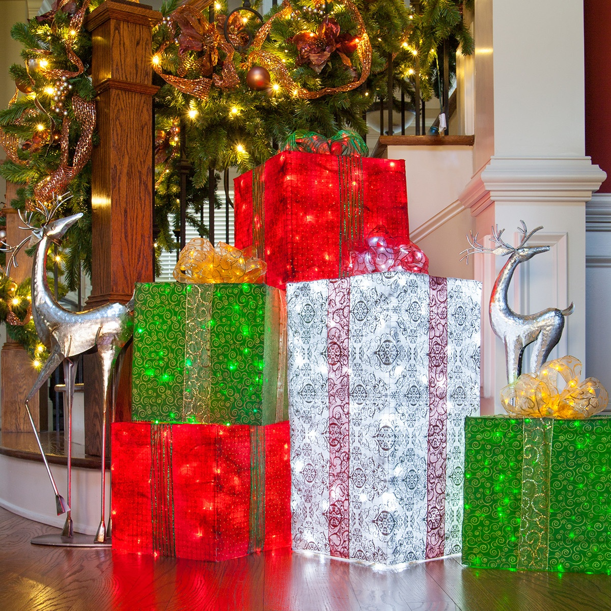 use chicken wire fabric and string lights to create diy lighted christmas presents - Light Up Presents Christmas Decorations