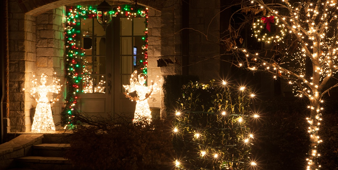 Place lighted angels or figurines on each side of the front door at Christmas time.