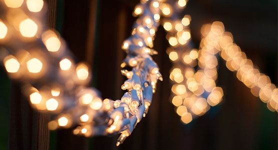 Garland lights are a fun way to decorate the porch for Christmas! Swag them down railings or outline the front door.