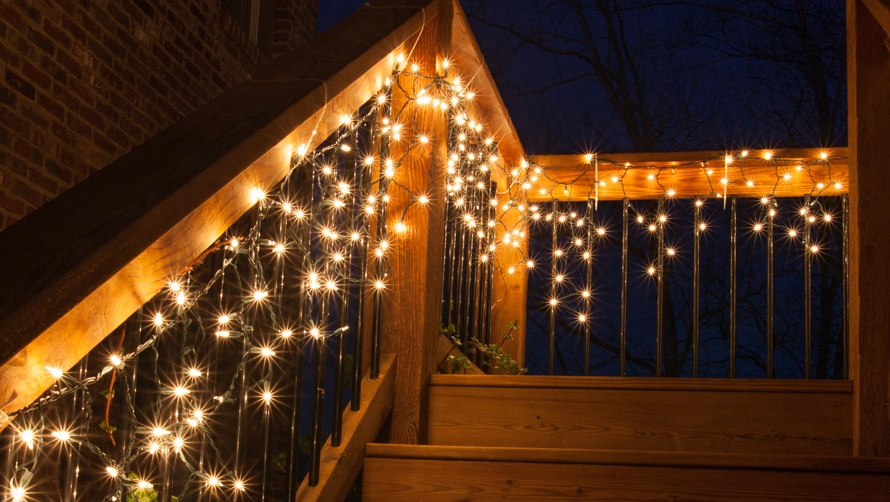 hang icicle lights down a staircase or across the front porch icicle lights staircase decoration - Railing Christmas Decorations