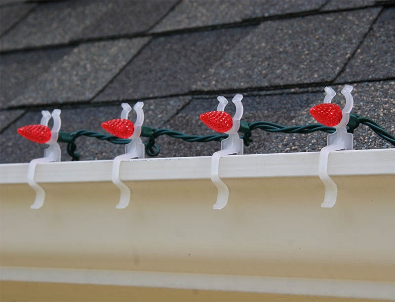 LED all in one light clip hangs mini string lights on gutters.