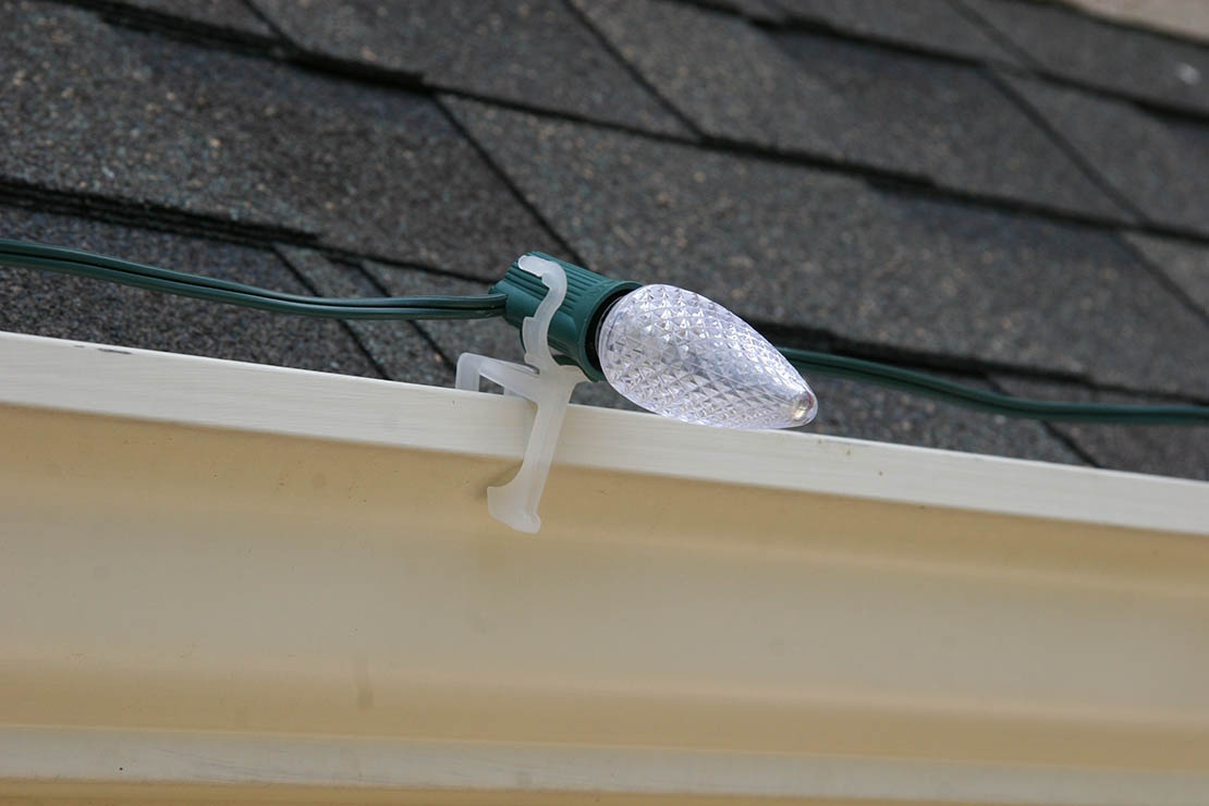 c9 Christmas lights held securely on gutters with the all in one light clip
