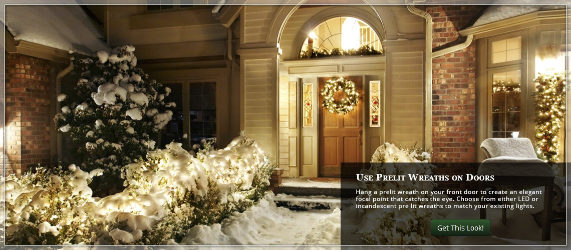decorate the front door with a prelit christmas wreath