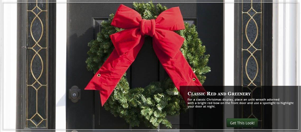 adorn a green wreath with a red Christmas bow