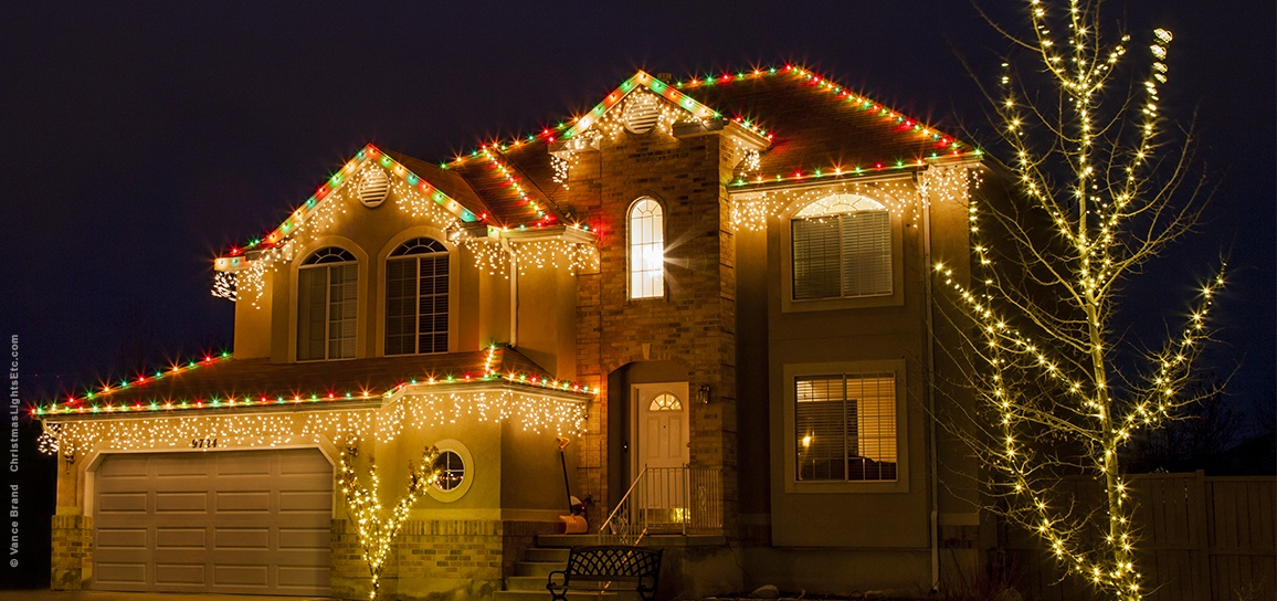 C9 bulbs and icicle lights combined across the roof - Outdoor Christmas Lights Ideas For The Roof