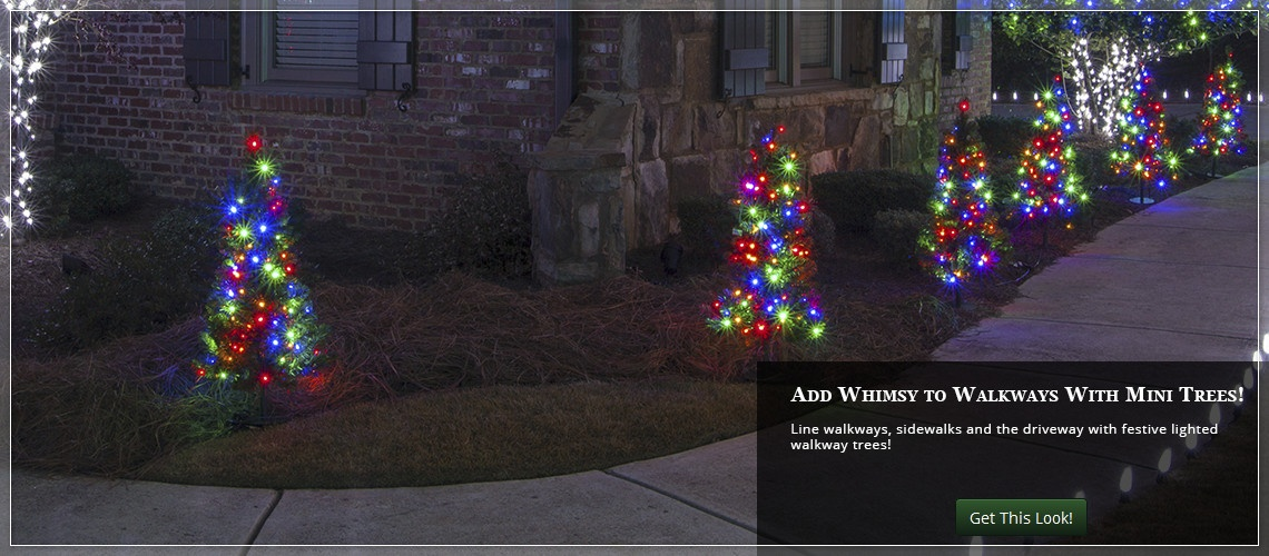Brighten your yard with walkway Christmas trees.