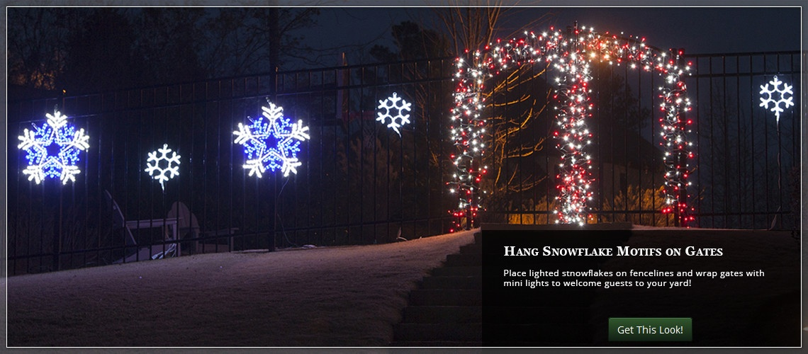 Add lighted snowflakes along the fence to liven up your Christmas yard decorations.