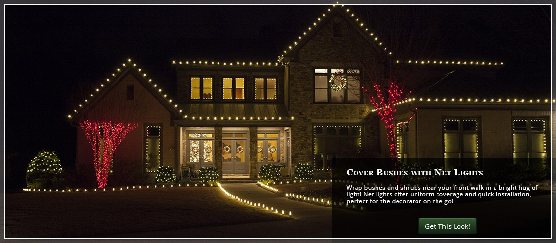 create uniform yard lighting quickly by wrapping bushes with net lights - Netted Christmas Lights