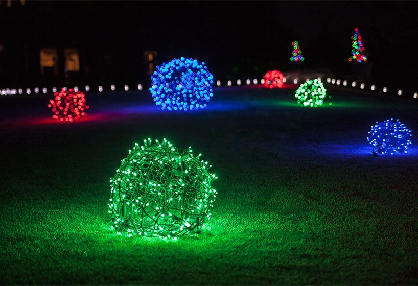DIY Christmas Light Balls Placed Throughout the Front Yard.