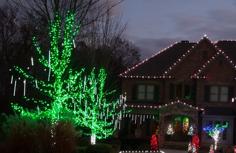 hang grand cascade led light tubes from tree branches in the yard