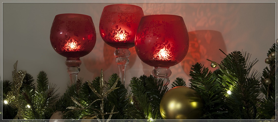 Decorate the mantel with Christmas candle holders