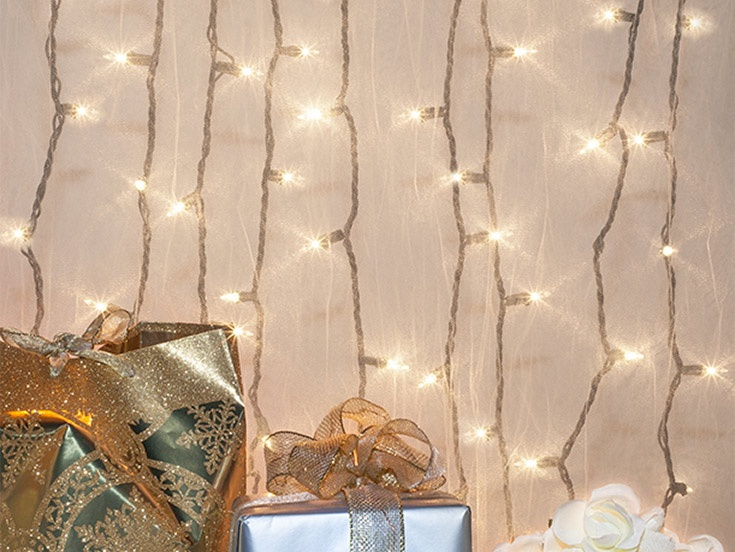Hang White Wire Icicle Lights Behind Sheer Fabric