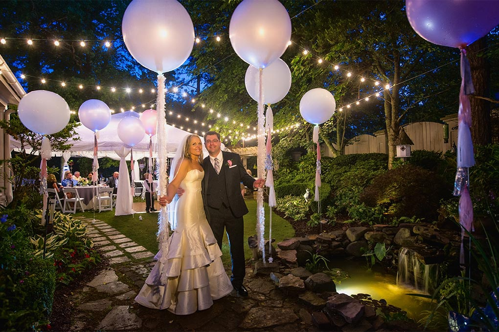 Wedding reception tent created using patio string lights