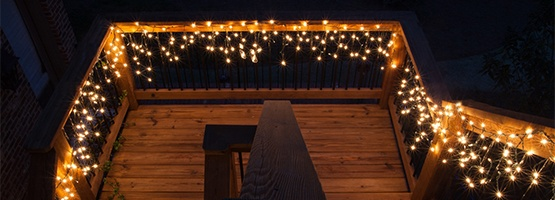 Icicle Lights Hanging Across Deck Railings