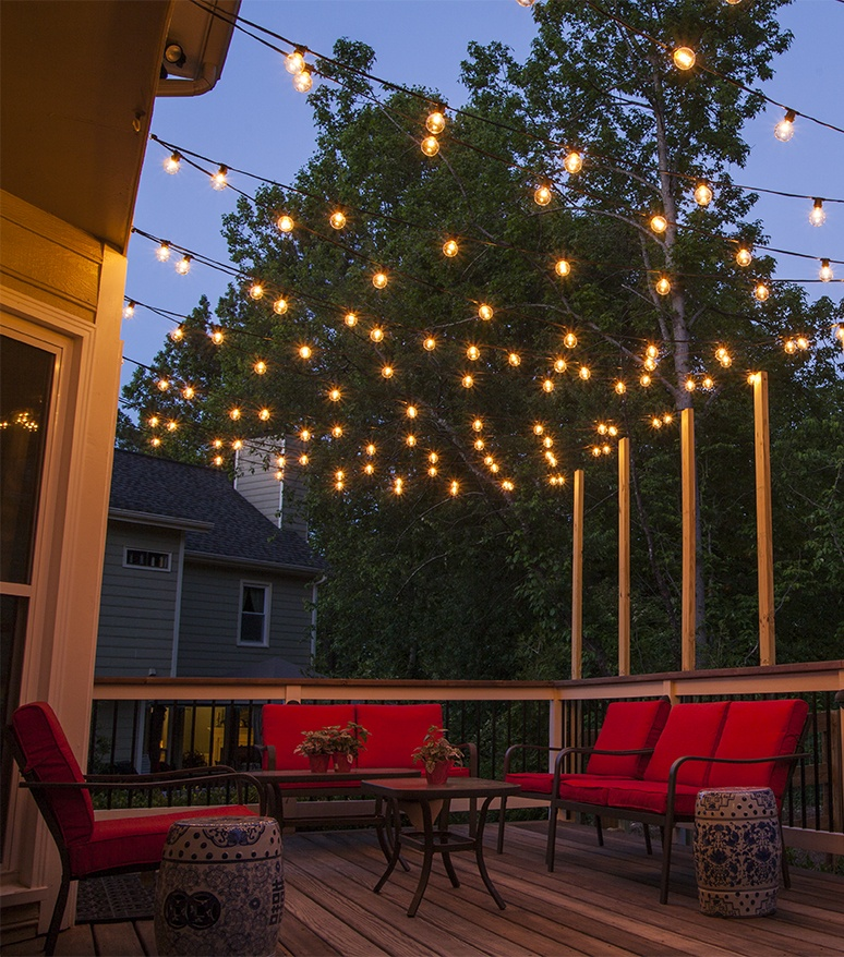 Genial Patio Lights Hanging Across A Backyard Deck