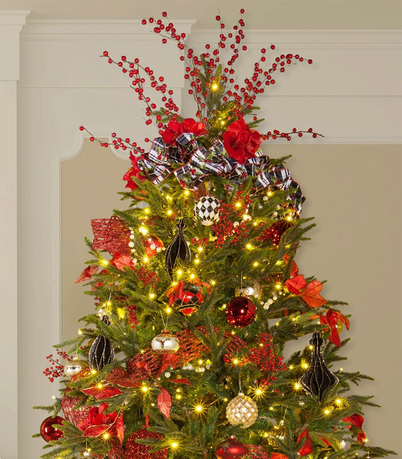 Prelit Christmas Tree Decorated with a Bow Tree Topper - Christmas Tree Toppers