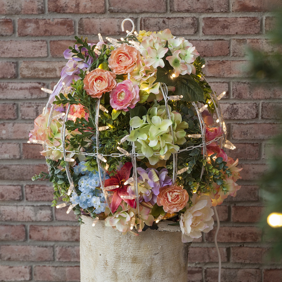Use a bounty of bright flowers in place of Christmas accents to create a light ball bursting with the fresh colors and textures of spring!