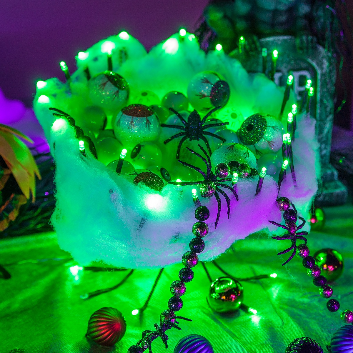 DIY Halloween Decoration - Creepy eyeball bowl made using starbust lighted branches