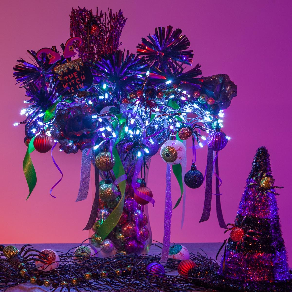 https://cdn.christmaslightsetc.com/images/CategoryDetail/56179/starburst-lighted-branches-halloween-decoration-0889.jpg