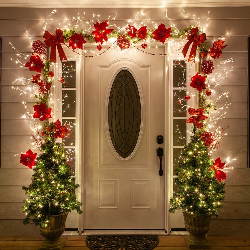 Christmas Door Decorating Ideas - Beautiful entry created using lighted branches and red poinsettias!