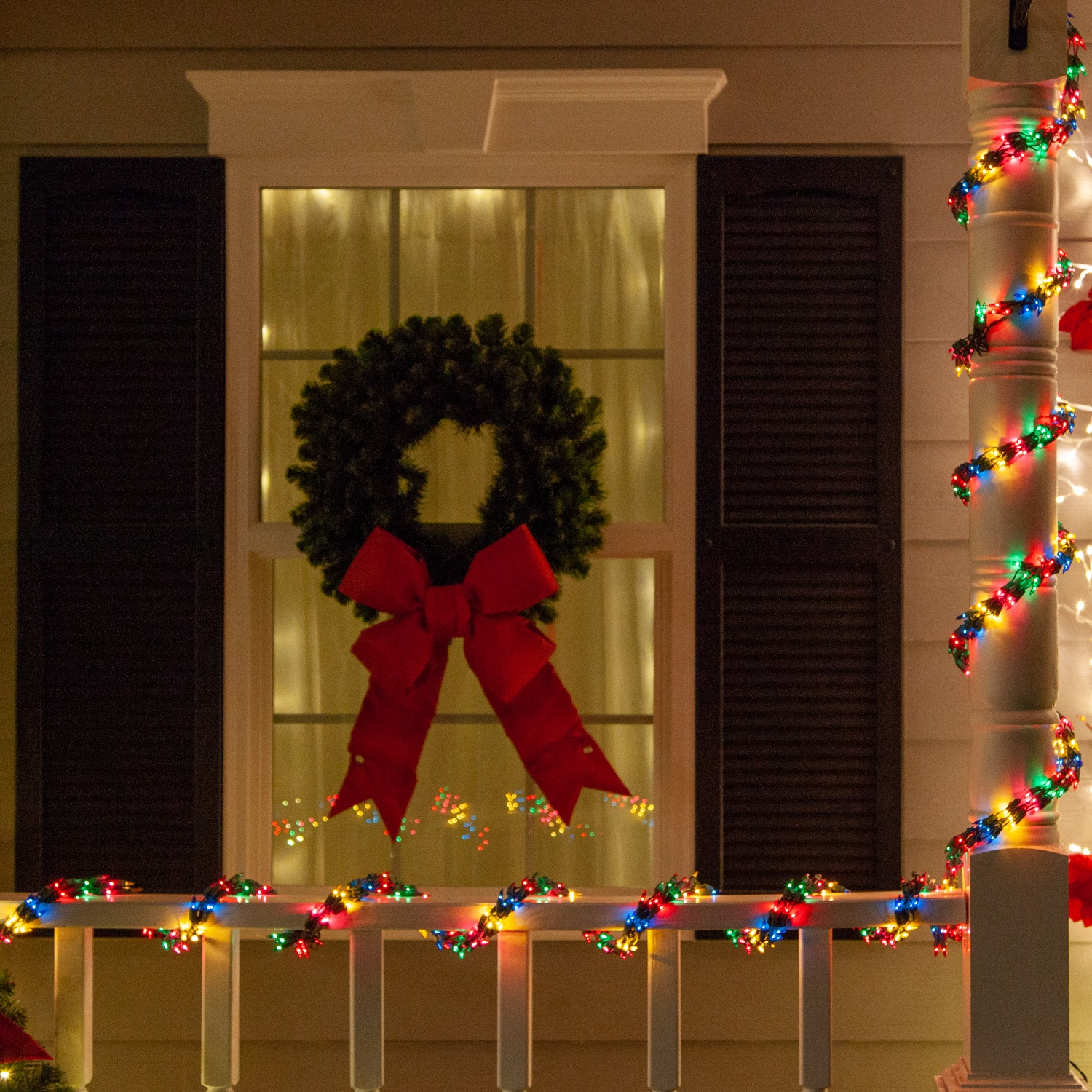 Multicolor Garland Lights Wrapped Around Porch Railings