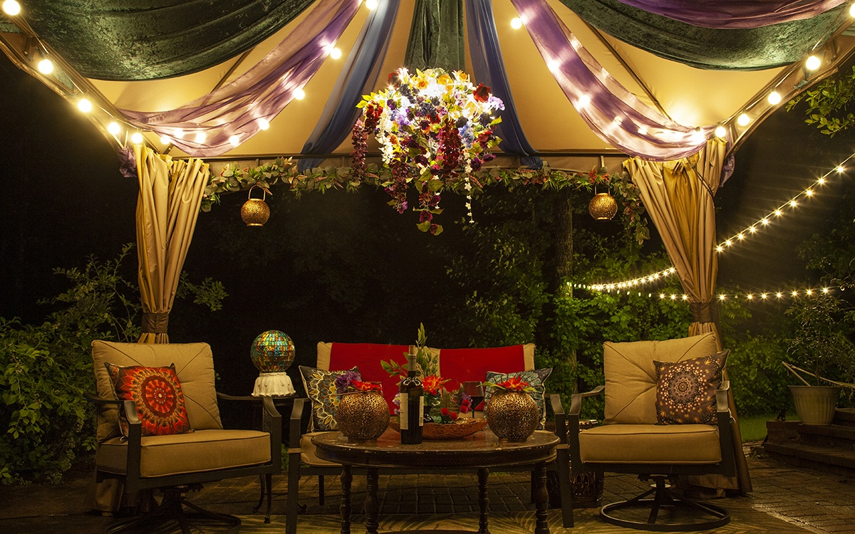 DIY Lighted Branches Chandelier Hanging Above a Patio Entertaining Area