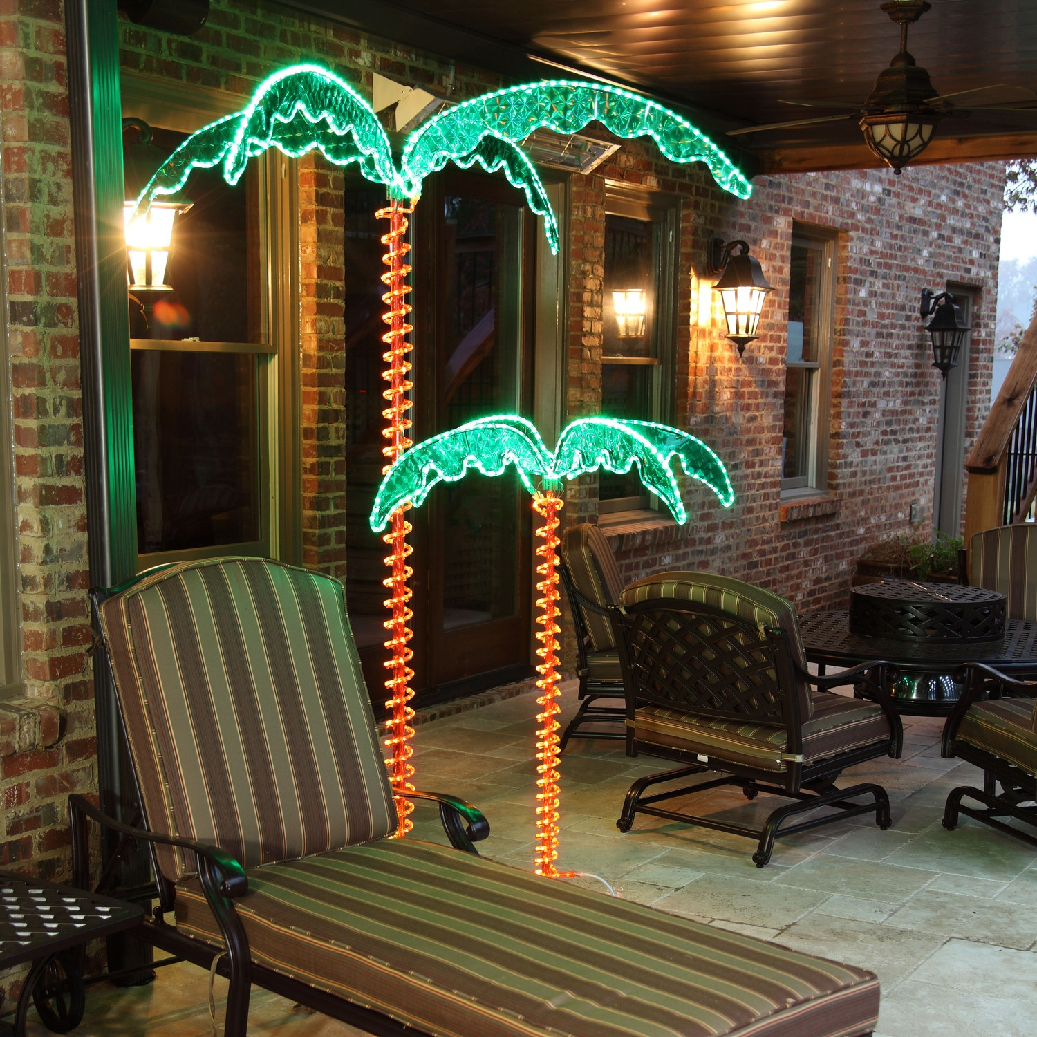 Lighted palm trees 4 5 39 deluxe led lighted palm tree for Outdoor light up ornaments