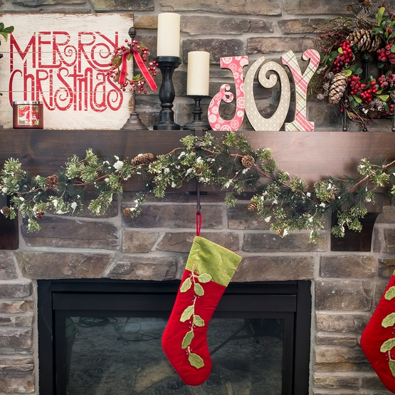 Carolers Displayed On A Mantle With Garland And Stockings: Mantel Hanger, Bronze